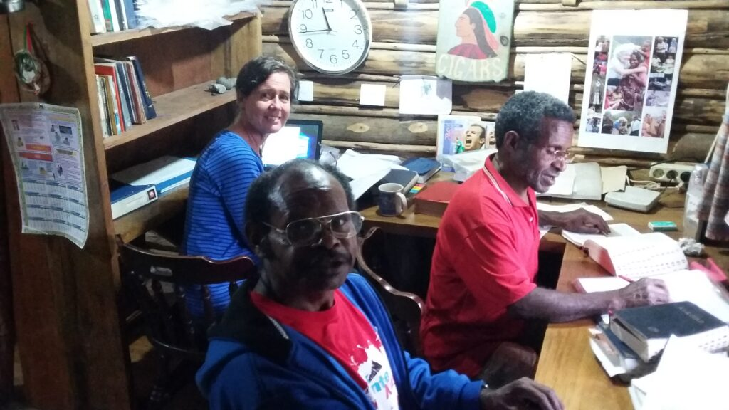 The translation cabin with Myrna, Amos and Enos.